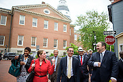 Annapolis, Maryland - May 12, 2015: Jessica Ennis, Earthjustice legislative representative, foreground left, Robin Dutta, representative for Maryland DC Virginia Solar energy industries association (MDV-SEIA), middle, and Luke Clippinger, Maryland delegate for district 46, and sponsor of the community solar bill, lead the pack out of the Maryland State House in Annapolis Tuesday May 12, 2015, for a celebratory lunch after the bill's signing. <br /> Background (L-R) Syeetah A. Hampton-El, Green & Healthy Homes Initiative, Jerry Brubach, solar advocate, and Mike Healy, from Nextility.<br /> CREDIT: Matt Roth for Earthjustice