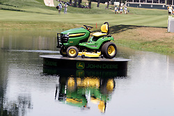 16 July 2006 A part of the spoils to winner John Senden. A John Deere Lawn tractor is on display in the lake on #18 and is a part of the prize package that John takes home. The John Deere Classic is played at TPC at Deere Run in Silvis Illinois, just outside of the Quad Cities