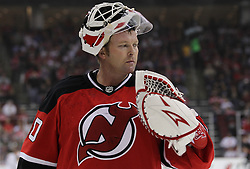 Oct 8; Newark, NJ, USA; New Jersey Devils goaltender Martin Brodeur (30) takes a break during a stoppage in the second period at the Prudential Center.