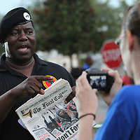 A member of the New Black Panther Party is seen prior to the trial of George Zimmerman at the Seminole County Courthouse, Saturday, July 13, 2013, in Sanford, Fla. Zimmerman had been charged for the 2012 shooting death of Trayvon Martin, and was found not guilty. (AP Photo/Alex Menendez)