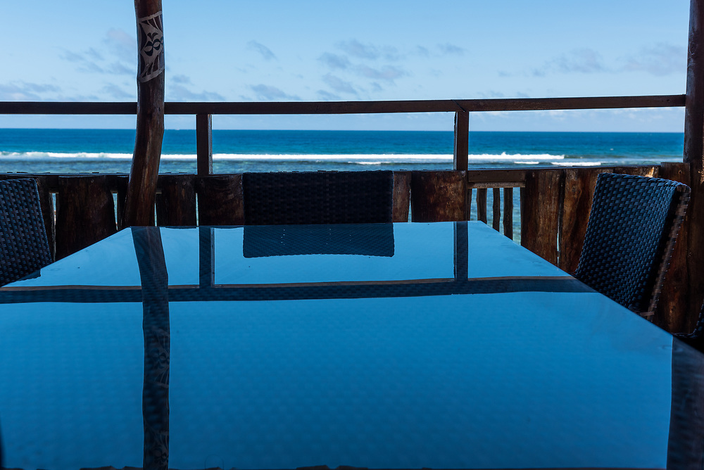Reflecting table with ocean in background