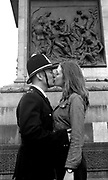 Gavin dressed as a Policeman and Girl kissing, Victoria Grove,  High Wycombe, UK, 1980s.