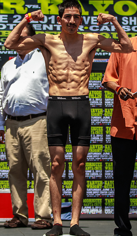 LOS ANGELES - JUNE 01: Boxer Leo 'Terremoto' Santa Cruz (19-0-1, 11 KO's) stopped the official scale at 117-pounds at Nokia Theater Plaza LA Live. All fees must be ageed prior to publication,.Byline and/or web usage link must read PHOTO Eduardo E. Silva/SILVEX.PHOTOSHELTER.COM Failure to byline correctly will incur double the agreed fee.