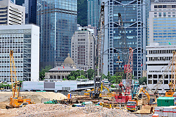 Major land reclamation construction in progress in Victoria Harbour in Hong Kong with the Hong Kong Convention Center to rear July 2008