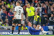Chelsea midfielder Mason Mount (19) reels in pain, Referee Cuneyt Cakir looks on, during the Champions League match between Chelsea and Valencia CF at Stamford Bridge, London, England on 17 September 2019.
