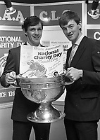 Meath All Star David Beggy and Dublins John O'Leary with the Sam Maguire Cup and the national charity day poster, at a reception to announce the details of the GAA National Charity Day, 10/02/1988 (Part of the Indepedent Newspapers Ireland/NLI Collection).