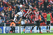 Millwall FC defender Shaun Hutchinson (4) and Sheffield United midfielder David Brooks (36) go for the ball in the air during the EFL Sky Bet Championship match between Sheffield United and Millwall at Bramall Lane, Sheffield, England on 14 April 2018. Picture by Ian Lyall.