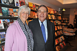 LORD & LADY BRITTAN OF SPENNITHORNE at a party to celebrate the publication of Sandra Howard's new book - Ex-Wives held at Daunt Books, 83 Marylebone High Street, London W1 on 30th April 2012.