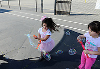 Clad in pink for a day with an anti-bullying message, girls play during a break at Loma Vista Elementary School in Salinas.