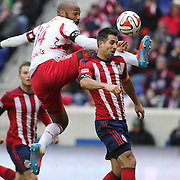 Thierry Henry, New York Red Bulls, wins a header over Carlos Bocanegra, Chivas USA, during the New York Red Bulls V Chivas USA, Major League Soccer regular season match at Red Bull Arena, Harrison, New Jersey. USA. 30th March 2014. Photo Tim Clayton