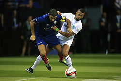 14 July 2017 -  Star Sixes Football - Robert Pires of France tangles with Jose Bosingwa of Portugal - Photo: Marc Atkins / Offside.
