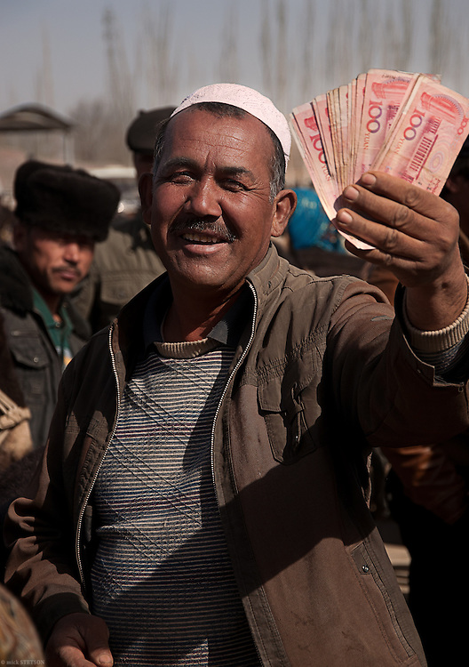 — The Uyghurs travel many hours to trade at the Sunday market, but some days yield greater profits than others, and greater satisfaction.