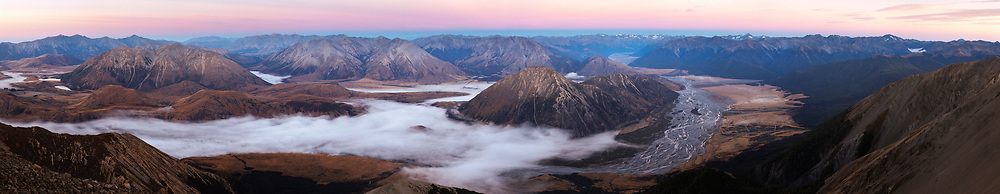 Wide view of the braided river Waimakariri before sunrise, mist in the river valley, looking west from Mt Binser. Canterbury, New Zealand