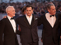 Producer Patrick McCormick, actor Johnny Depp, producer John Lesher, at the gala screening for the film Black Mass at the 72nd Venice Film Festival, Friday September 4th 2015, Venice Lido, Italy.