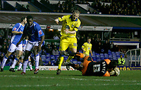 Birmingham keeper Colin Doyle gathers under pressure from Leeds Kevin Nicholls (18)