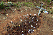 "All Souls' day in a cemetery in Benjamin Constant. Brasil..The people who live there call the tri-border area between Colombia, Brazil and Perù ""La Frontera"".  This area, in the past rich field for seringueiros (rubber gatherer) and most recently narcos' territory, don't keep trace of the wealth generated here but spent elsewhere. Amazon frontiers areas are notorious for their sparse population and limited state presence."