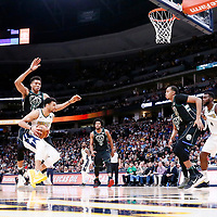 01 April 2018: Denver Nuggets guard Jamal Murray (27) drives past Milwaukee Bucks forward Giannis Antetokounmpo (34) during the Denver Nuggets 128-125 victory over the Milwaukee Bucks, at the Pepsi Center, Denver, Colorado, USA.