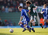 Kevin Cooper for Cardiff holds off the challenge  of Plymouths Lilian Nalis<br /> <br /> Photo: Richard Eaton.<br /> <br /> Plymouth Argyle v Cardiff City. Coca Cola Championship. 18/03/2006.