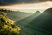 First light breaks over Peter's Stone and illuminates the banks of Cressbrook Dale, Derbyshire. A beautiful Spring morning in the Peak District National Park, England, UK. May, 2016