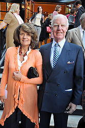 SIR JOCELYN STEVENS and his wife EMMA at a reception for the Castle of Mey held at the Goring Hotel, London on 19th May 2009.