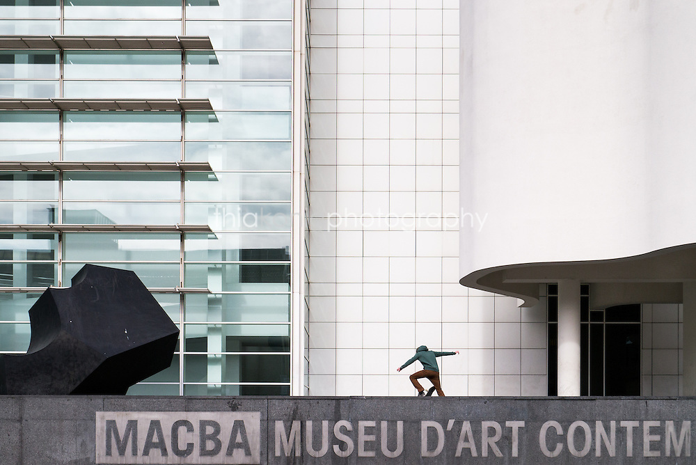A skateboarder does a trick in front of the MACBA Museum of Contemporary Art in Barcelona, Spain.
