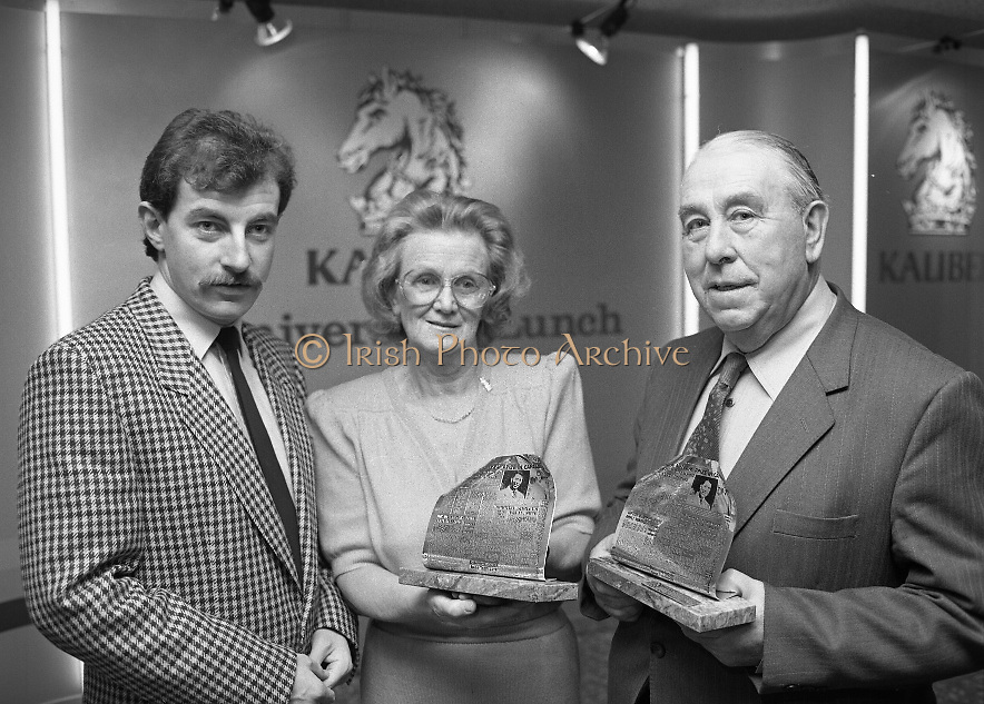 Harry Bradshaw - Christy O'Connor..1986..26.11.1986..11.26.1986..26th November 1986..To commemorate the anniversary of their winning of The Canada Cup in 1956 a presentation was made to Harry Bradshaw and Christy O'Connor. Mr Paul Keogh made the presentation on behalf of,sponsor,Kaliber Lager. The duo won the cup in Mexico City,Mexico..Pictured are Mr Paul Keogh,Senior Brand Manager,Kaliber Lager,Mrs Mary O'Connor,wife of Christy, who accepted the award on his behalf and Mr Harry Bradshaw.