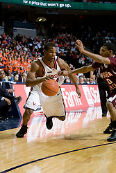 Virginia guard Sean Singletary (44) dribbles past Virginia Tech guard Hank Thorns (10).  The Virginia Cavaliers men's basketball team faced the Virginia Tech Hokies at the John Paul Jones Arena in Charlottesville, VA on January 16, 2008.