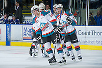 KELOWNA, CANADA - JANUARY 2: Cody Fowlie #18 and Dylen McKinlay #19 of the Kelowna Rockets celebrate a goal against the Victoria Royals at the Kelowna Rockets on January 2, 2013 at Prospera Place in Kelowna, British Columbia, Canada (Photo by Marissa Baecker/Shoot the Breeze) *** Local Caption ***