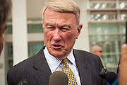 21 AUGUST 2012 - PHOENIX, AZ: JOHN J. BOUMA, chairman of Snell and Wilmer, the firm defending Arizona in the ongoing lawsuits surrounding SB 1070, talks to reporters after a hearing in Phoenix Wednesday. A handful of protesters waited outside the Sandra Day O'Connor Courthouse in Phoenix Wednesday while lawyers from the American Civil Liberties Union (ACLU) and Mexican American Legal Defense and Education Fund (MALDEF) sparred with lawyers from Maricopa County and the State of Arizona over the constitutionality of section 2B of SB 1070, Arizona's tough anti-immigrant law. Most of the law was struck down by the US Supreme Court in June, but the Justices let section 2B stand pending further review. The suit is being heard in District  Judge Susan Bolton's court. It was Judge Bolton who originally struck down SB 1070 in 2010. A ruling is expected later in the year.   PHOTO BY JACK KURTZ