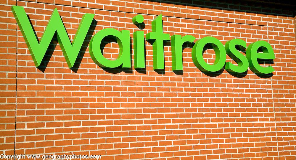 Waitrose shop sign on brick wall