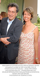 MISS SABRINA GUINNESS and film director STEPHEN FREARS at a party in London on 24th June 2003.PKW 35