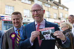 "© Licensed to London News Pictures. 20/05/2017. LONDON, UK.  PAUL NUTTALL, UKIP leader holds a leaflet showing a picture of Theresa May, captioned ""Beware of scams"" as he campaigns in Elm Park with UKIP candidate for Dagenham and Rainham, PETER HARRIS. All political parties continue to campaign across the UK ahead of the general election taking place on 8th June. Photo credit: Vickie Flores/LNP"