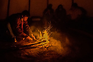 Peyote ceremony, Native American Church, fire man tends fire, Crow Indian Reservation, Montana