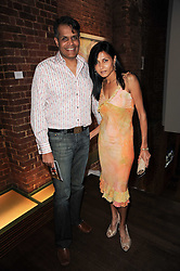 JAAN & KAUS PATEL at a private view of Sacha Jafri's paintings entitled 'London to India' held in aid of The Elephant Family charity at 23 Macklin Street, Covent Garden, London on 3rd June 2010.
