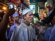 20 OCTOBER 2015 - YANGON, MYANMAR:  A Burmese Shia man participates in an Ashura procession at Punja Mosque in Yangon. Ashura commemorates the death of Hussein ibn Ali, the grandson of the Prophet Muhammed, in the 7th century. Hussein ibn Ali is considered by Shia Muslims to be the third imam and the rightful successor of Muhammed. He was killed at the Battle of Karbala in 610 CE on the 10th day of Muharram, the first month of the Islamic calendar. According to Myanmar government statistics, only about 4% of the population is Muslim. Many Muslims have fled Myanmar in recent years because of violence directed against Burmese Muslims by Buddhist nationalists.   PHOTO BY JACK KURTZ