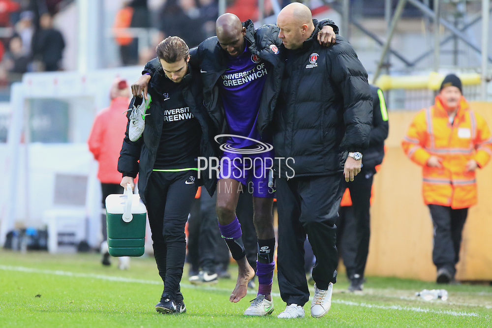 Charlton Athletic midfielder Alou Diarra is helped off the pitch at half time during the Sky Bet Championship match between Bristol City and Charlton Athletic at Ashton Gate, Bristol, England on 26 December 2015. Photo by Jemma Phillips.