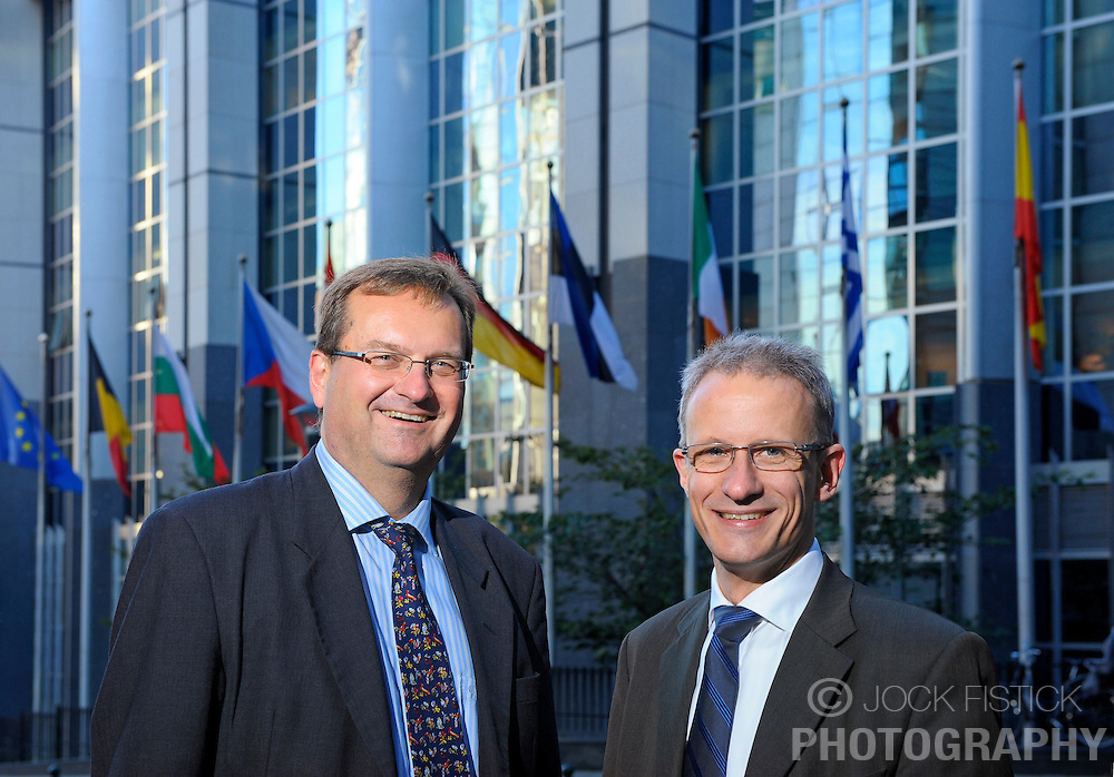 BRUSSELS, BELGIUM - OCT-14-2009 - REPORTAGE FOR ERICSSON CONTACT MAGAZINE - ..Magnus Madfors, Director of Ericsson's R&D policy, left, and Mats Nilsson, Vice President of Ericsson's European Affairs Office, right, outside the European Parlimanet in Brussels. (Photo © Jock Fistick)