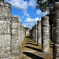 Hall of the Thousand Columns at Chichen Itza, Mexico<br /> Adjacent to the Temple of the Warriors is the Hall of the Thousand Columns. Grupo de las Mil Columnas is considered to be a former residence complex for the social and governmental elite. The colonnades define a large square plaza with the ruins of council halls, temples and a ball court.