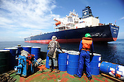 11-10-12 -   LOME, TOGO -  Preparing for a crew change with the RBD Anema E Core in the Lomé anchorage in Togo, West Africa on October 12, 2011. The tanker vessel was attacked by pirates in Beninese waters in July 2011. The threat of piracy in Benin has prompted ships to seek safer anchorage in Togolese waters, however many are concerned that pirates will follow the vessels.  Photo by Daniel Hayduk