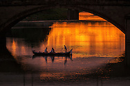 Europe, Italy, Tuscany, Toscana, Firence, Florence, boat on Arno river at sunset