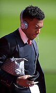 Daniel Sturridge of Liverpool arrives at the stadium before the Barclays Premier League match at Anfield, Liverpool<br /> Picture by Russell Hart/Focus Images Ltd 07791 688 420<br /> 22/03/2015