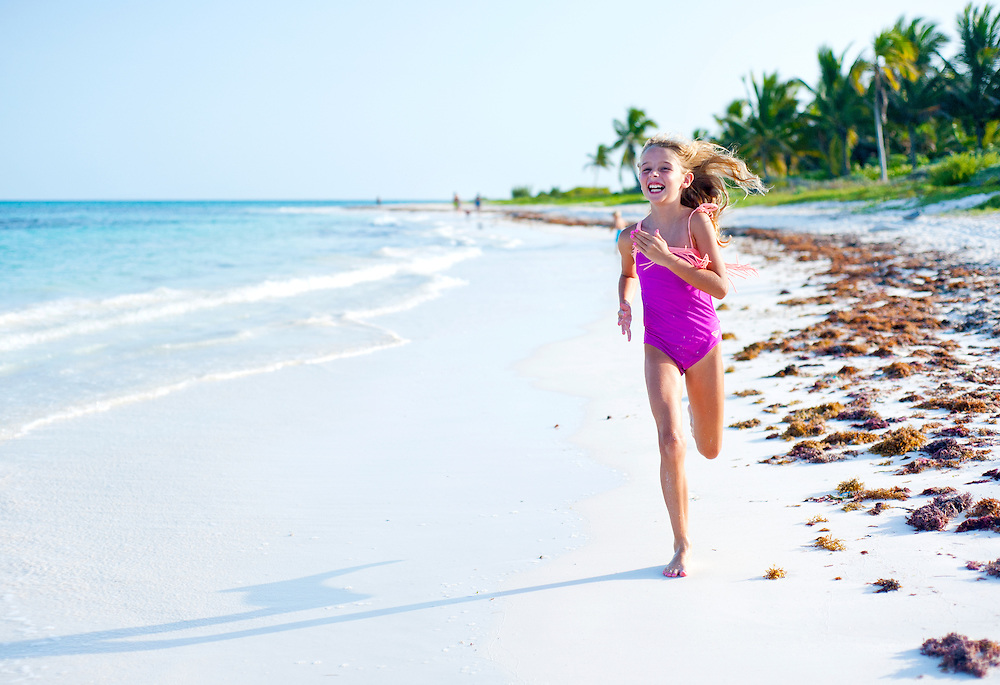 Kid running on beach, Mexico
