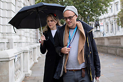 © Licensed to London News Pictures. 09/10/2019. London, UK. Special adviser to the Prime Minister Dominic Cummings (r) and  Cleo Watson (l) arrive at Downing Street .  Photo credit: George Cracknell Wright/LNP