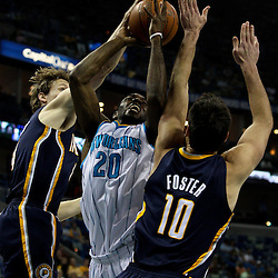 April 3, 2011; New Orleans, LA, USA; New Orleans Hornets small forward Quincy Pondexter (20) is defended by Indiana Pacers small forward Mike Dunleavy (left)  and Indiana Pacers center Jeff Foster (right) during the first quarter at the New Orleans Arena.    Mandatory Credit: Derick E. Hingle