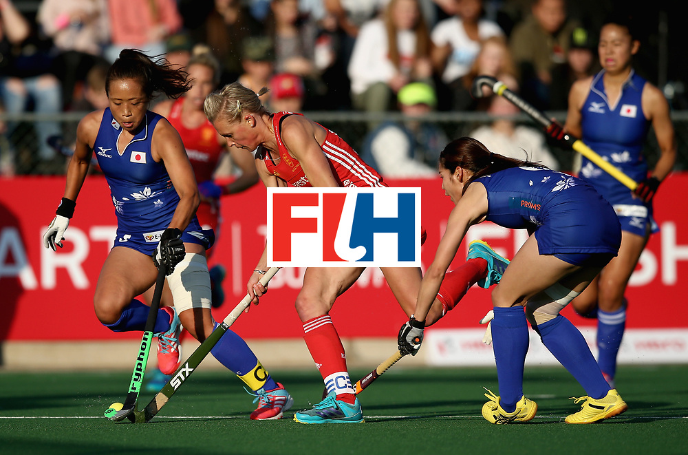 JOHANNESBURG, SOUTH AFRICA - JULY 12: Alex Danson of England is challenged by Shihori Oikawa and Natsuki Naito of Japan during day 3 of the FIH Hockey World League Semi Finals Pool A match between Japan and England at Wits University on July 12, 2017 in Johannesburg, South Africa. (Photo by Jan Kruger/Getty Images for FIH)