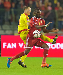 BRUSSELS, BELGIUM - Sunday, November 16, 2014: Belgium's Christian Benteke and Wales' James Chester during the UEFA Euro 2016 Qualifying Group B game at the King Baudouin [Heysel] Stadium. (Pic by David Rawcliffe/Propaganda)