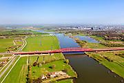 Nederland, Gelderland - Overijssel, Hattem, 01-05-2013; IJsselbrug, spoorbrug bij Hattem voor de Hanzelijn. In de achtergrond de brug voor regionaalautoverkeer en de brug in rijksweg A28 naar Zwolle. IJsselstein in de voorgrond.<br /> De 'Hanzeboog' is ontworpen door  Quist Wintermans Architecten.<br /> Bridges over the river IJssel near Zwolle. The red railway bridge Hanzeboog (Hanseatic arch) over the IJssel near Zwolle, has been designed by Quist Wintermans Architects.  <br /> luchtfoto (toeslag op standard tarieven);<br /> aerial photo (additional fee required);<br /> copyright foto/photo Siebe Swart
