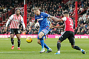 Bolton Wanderers defender David Wheater (31) battles with Brentford midfielder Emiliano Marcondes (17) during the EFL Sky Bet Championship match between Brentford and Bolton Wanderers at Griffin Park, London, England on 22 December 2018.