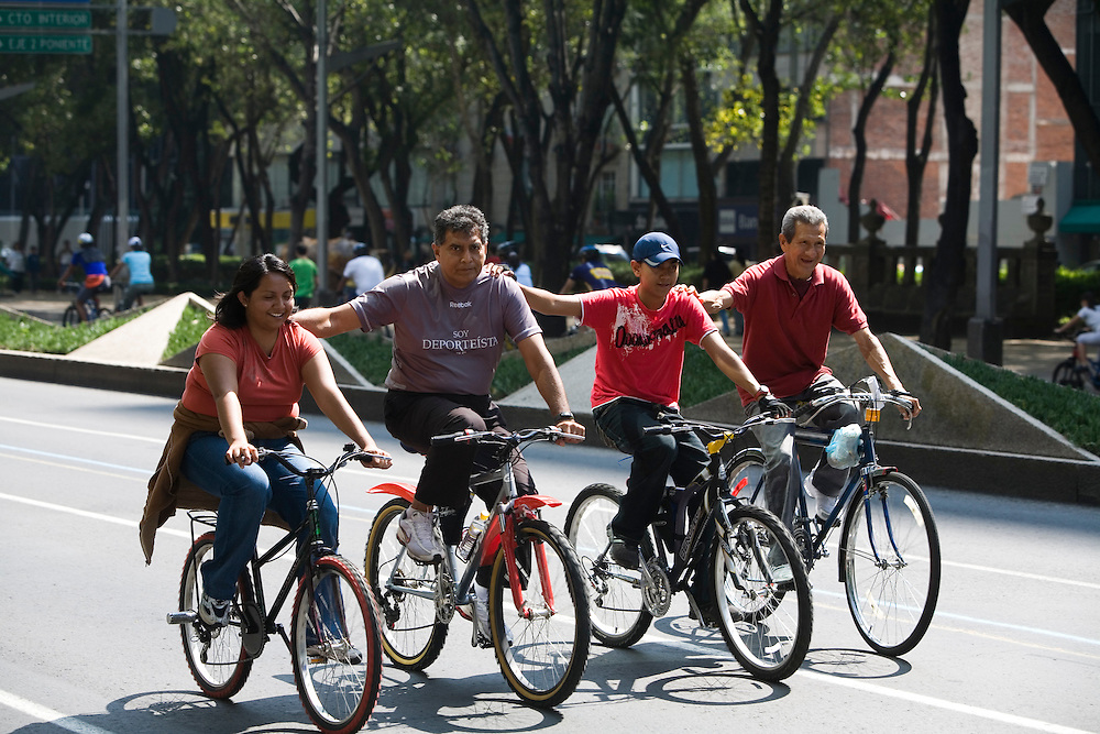 People ride bikes on Paseo La Reforma, one of the main streets in Mexico City.  Every Sunday the street is closed off for bikers and joggers to exercise.