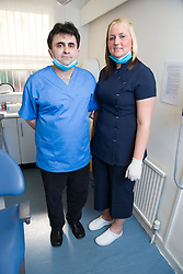 Dentist in consultation with patient,